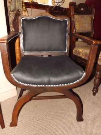 x-frame mahogany throne chair with black hide finish... wow