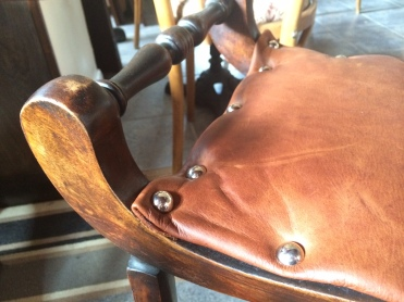 georgian stool close up; thick studded leather